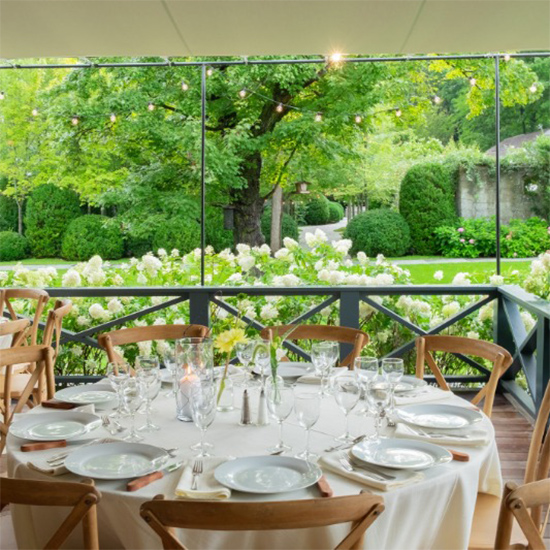 Dining table setup on the Deck at Valley Rock Inn & Mountain Club